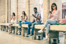 Group of young persons on their smartphones