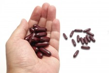 Handful of capsules via Shutterstock