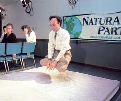 In 1996, before everyone had an HD camera in their phone, gullible people were convinced by crappy pictures like this, and Bigfoot, and UFOs. Here is Jeffrey Smith demonstrating Jeffrey Smith demonstrating yogic flying during a Natural Law Party press conference in Springfield, Ill., on Oct. 22, 1996, where he was a member of a party delegation from Iowa. (Image freely licensed and released for public use.)