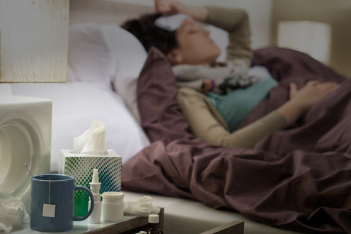 Avoiding stress could help stave off the flu. Sick woman via www.shutterstock.com.