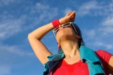 Athlete wiping off sweat via Shutterstock