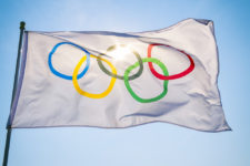 Olympic flag via Shutterstock