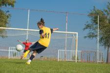 Teenage soccer player via Shutterstock