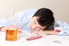 Asian man having difficulty with alcohol via Shutterstock