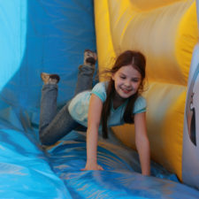 Girl playing in Bounce House, via Shutterstock